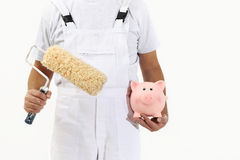 Painter man with roller brush and piggy bank, isolated on white Stock Photography