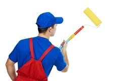 Painter man in uniform with paint Stock Image