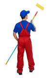 Painter man in uniform with paint roller Stock Images
