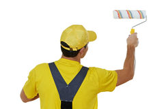 Painter man in uniform with paint roller Stock Photography