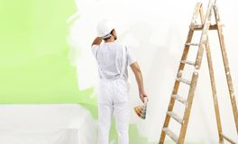 Painter man at work with color swatches samples, wall painting g. Reen color ecological concept, web banner template stock photo