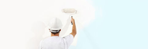 Painter man at work with a paint roller isolated , web banner Royalty Free Stock Photos