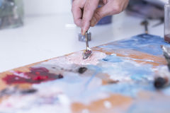 Painter mixing paint - painting session Stock Images