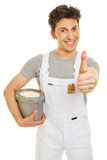 Painter with paint bucket holding thumb up Royalty Free Stock Photography