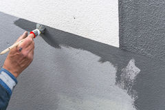 Painter with paint roller in hand Stock Image