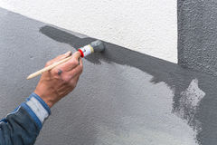 Painter with paint roller in hand Royalty Free Stock Image