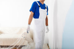 Painter with paint roller Stock Photography