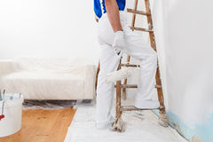 Painter with paint roller and ladder Stock Photos