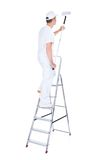 Painter with paint roller and ladder Stock Image