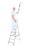 Painter with paint roller and ladder. Mature Male Painter With Paint Roller And Ladder Over White Background Royalty Free Stock Images