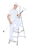 Painter With Paint Roller And Ladder Royalty Free Stock Photo
