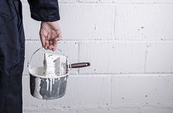 Painter with paint tin and brush Royalty Free Stock Photo