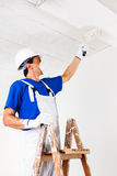 Painter painting ceiling with paint roller Stock Images