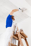 Painter painting ceiling with paint roller Royalty Free Stock Photos