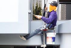 The painter is painting condominium in bangkok Royalty Free Stock Photos