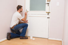 Painter painting the door white Stock Images