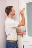 Painter painting the door white Royalty Free Stock Photo