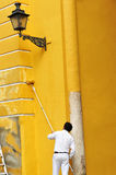 Painter painting the facade of a ancient buildind with roller, Spain Royalty Free Stock Photography