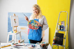 Painter painting at her studio Royalty Free Stock Images