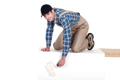 Painter painting a rectangle Stock Photography
