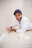 Painter painting the skirting boards Stock Image
