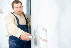 Painter painting the wall Royalty Free Stock Photos