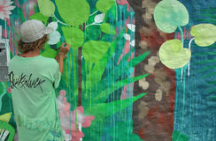 Painter painting a wall mural Royalty Free Stock Photo