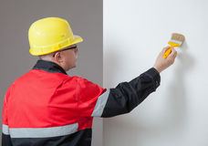 Painter painting a wall Stock Photos