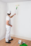 Painter Painting On Wall Stock Photography