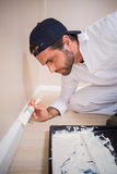 Painter painting the walls white Royalty Free Stock Photos