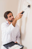 Painter painting the walls white Royalty Free Stock Images