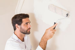 Painter painting the walls white Stock Photo