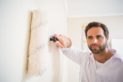 Painter painting the walls white Royalty Free Stock Photography