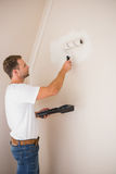 Painter painting the walls white Stock Photos