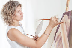 Painter paints. Stock Image