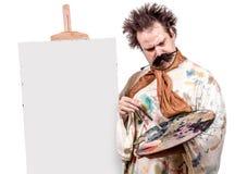 Painter paints on canvas Stock Images