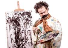 Painter paints on canvas Stock Photo