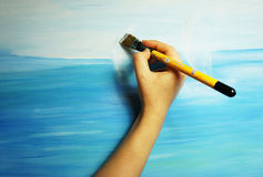 Painter paints his beautiful picture Royalty Free Stock Images