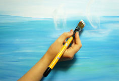 Painter paints his beautiful picture Stock Photo