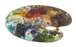 Painter palette. Old painter palette made of wood with paintings of various colors Royalty Free Stock Images