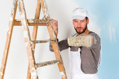 Painter pointing at you the paint brush Stock Image