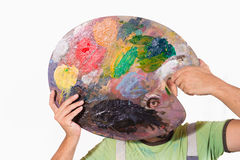 Painter portrait with palette Stock Image