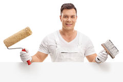 Painter posing behind a blank panel Royalty Free Stock Photo