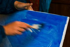 Painter prepare canvas for drawing. Beautiful artistic background. hand motion blur, speed drawing concept stock photos