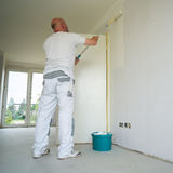 Painter during the renovation royalty free stock image