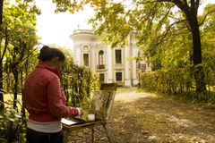 Painter in residence. Painter in autumn park. Kuskovo Residence. Moscow royalty free stock images