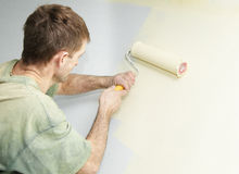 Painter with roller Royalty Free Stock Photography