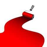 Painter roller dyes a red paint Royalty Free Stock Photos