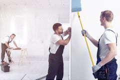 Painter with roller painting wall on blue while redecorating interior. Painter with roller painting a wall blue while redecorating interior royalty free stock images