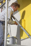 Painter with roller working Stock Image
